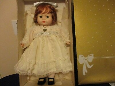 Horsman porcelain Baby Doll Lynette Vintage yellow dress, heart necklace, red ha