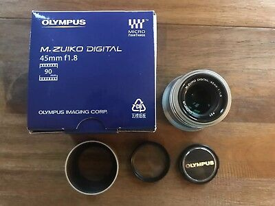 Olympus M. Zuiko 45mm f1.8 silver lens with uv filter and hood