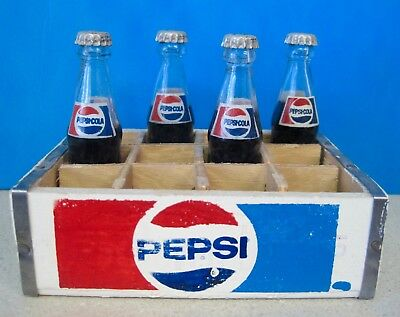 Four Collectible Miniature Pepsi Bottles in Wooden Crate