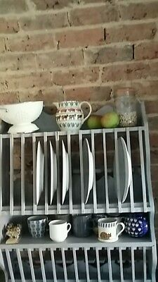 Beautiful old character plate rack..