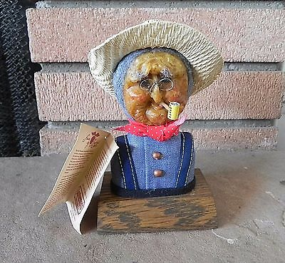APPLE SCULPTURE FARMER FIGURINE Leathermans Muriel Rauland