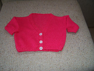 New Hand Knitted Short Sleeved  Cardigan / Bolero  Coral .   4-5   Years Approx