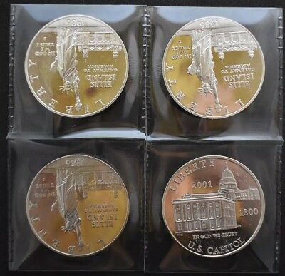 Silver Dollars (4 Coins) Commemorative in capsules lot 102