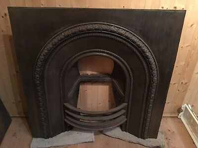 Original arched cast iron antique insert fireplace from 1840's.