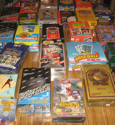 storage locker clean-out  sealed unopened baseball football packs 150 cards !!