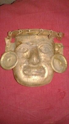 Golden gold mask tumbaga with its crown all in golden gold, moche.mochica,copper
