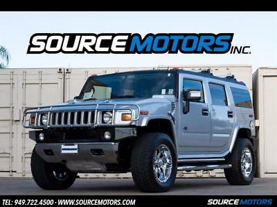 2009 Hummer H2 Luxury 2009 Hummer H2 Luxury, Leather, Navigation, DVD, Silver Ice, Center Captains