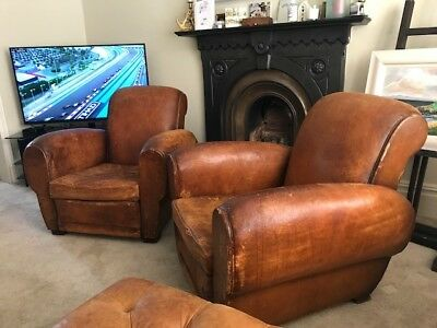 Matching pair of French Vintage Leather Club Chairs