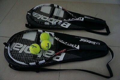 Two Tennis Racquets with carry bags and tennis balls