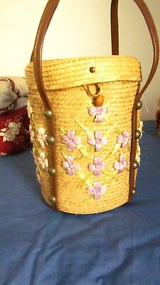 1950,s floral straw/raffia tall basket with flowers.Fab!Basket measures 11 1/2 i
