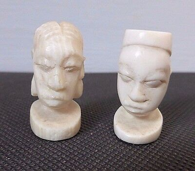 Two rare decorative tribal African art carved heads possibly game pieces amulets