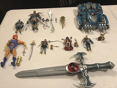 thundercats action figures lot  8 figures and includes tank and sword of omens