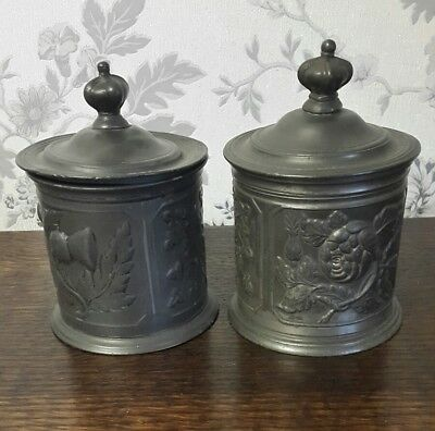 A Near Pair of Antique Pewter Lidded Jars, Embossed