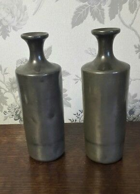 A Pair of Antique Pewter Bottles