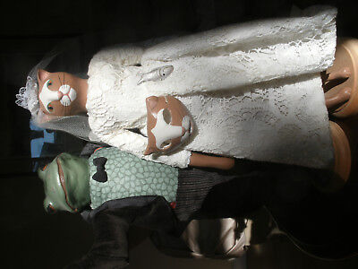 Tracy Gallup bride and groom dolls on stands