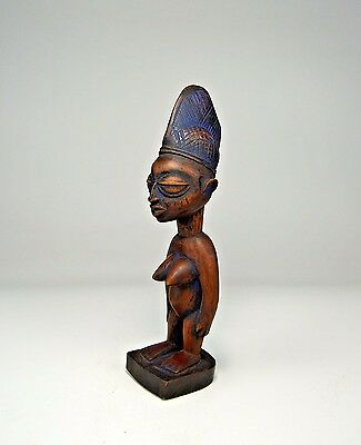 A vintage Yoruba Female Ibeji twin idol with Indigo pigment, Africa