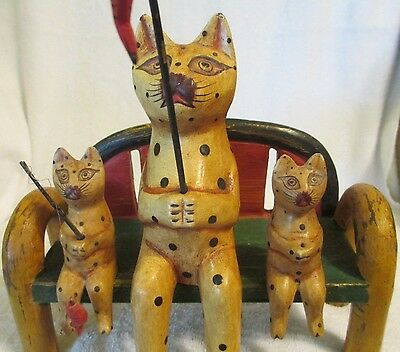 """Three Wooden Cats Sitting on a Bench Fishing. 8"""" tall, 9"""" wide Made Indonesia"""