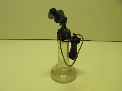 Old candlestick style telephone candy container. diecast cap & top