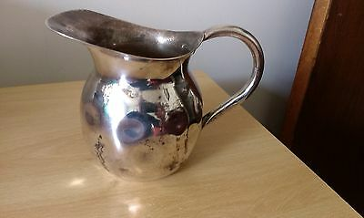 small silver plated wine pitcher
