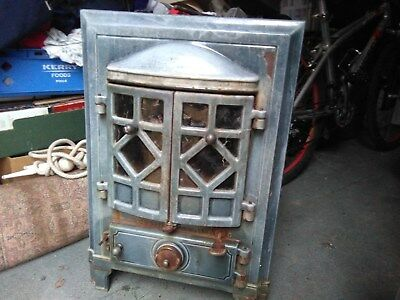 Antique French stove, fire, in gorgeouslight greenenamel