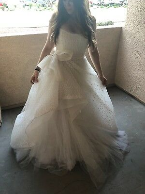 a Rita Vineris ivory wedding gown size 10 (model is size 5 typically) brand new