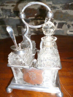 Silver Plated Four Bottle Cruet Set And Stand With Escutcheon