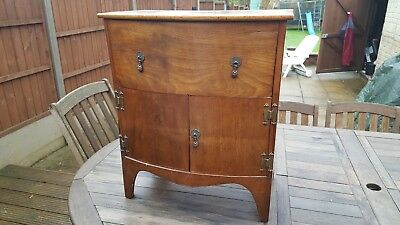 Antique commode converted to storage cabinet