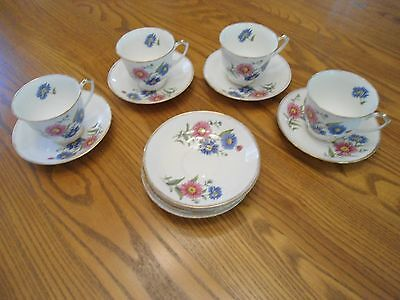 Set 4 of Salisbury bone china cups and  with 4 extra saucers made in England