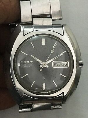 Seiko 7006-7080,S#671596 automatic men watch,40mm,WORKING,with Stelux Band