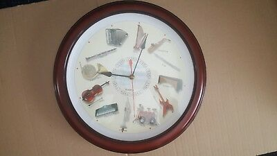 "Instrumental 13"" MUSICAL QUARTZ WALL CLOCK (PLAYS 12 SOUNDS  ON THE HOUR)"