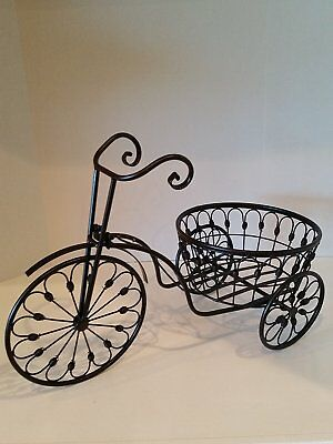 Vintage Tricycle Wrought Iron Plant Stand is the perfect decorative Plant Stand