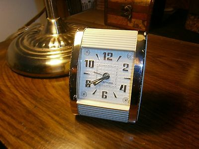 vintage westclox portable alarm clock, works perfect, with alarm cream color