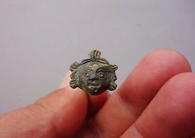 ancient Roman bronze face of young god Eros (Cupid)