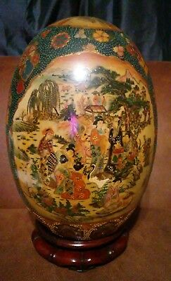 Antique 19th century signed large porcelain oriental egg on wood stand