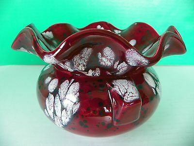 Pottery art fluted bowl; dark red with white and black designs