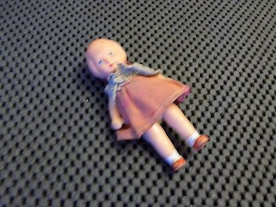 Vintage small rubber doll