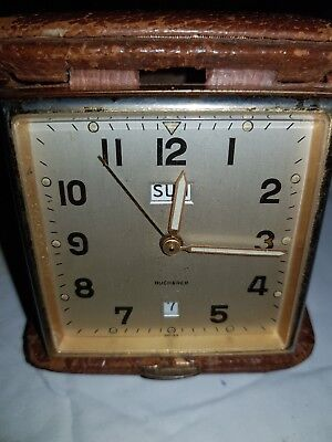 Vintage clock MADE IN SWISS in excellent  condition for the age