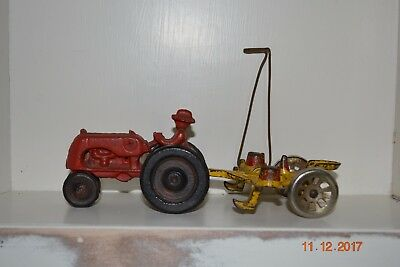 Antique Cast Iron Hubley Farm Tractor Pulling a Yellow and Red Arcade Planter