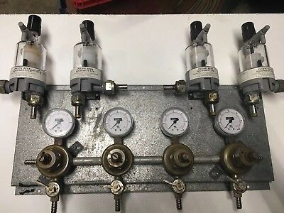 2 used 4 way Perlick regulator panels includes fobs. Will supply 8 total kegs.