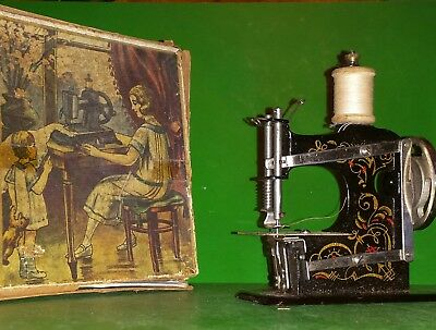Antique Muller's Hand sewing machine model number '0' with box and instructions