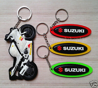 4x SUZUKI Motorcycle Soft Rubber Keychain Double side Cambered Ellipse Logo SM2