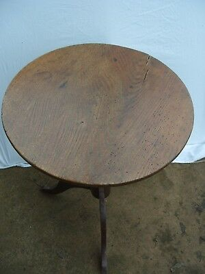 Antique Georgian tilt top oak tripod based small round table.