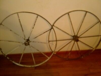 A pair of early 1900s Cast Iron 30 inch Wagon Wheels 10 spoke in good condition