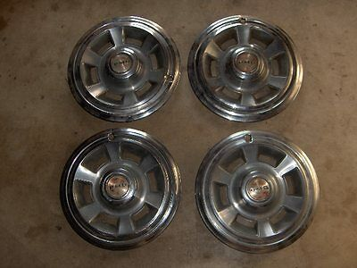 "Pontiac Le Mans, GTO, Firebird OEM Used PMD Hubcaps 14""  1969-70"