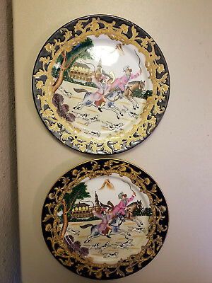 A pair of asian/chinese plates featuring riding horse and dog hunting