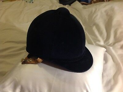 Charles Owen navy blue riding hat size 54 with flesh colour straps