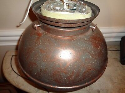 Copper Colored Round with Thin Wires Below Ceiling Light Fixture Green Flecks