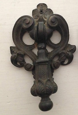 A Victorian pair of patinated brass pendant knob door knockers