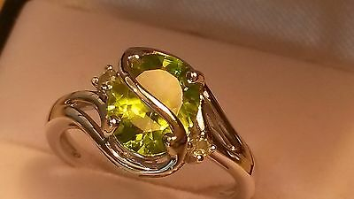 Natural designer inspired AA peridot ring in silver size M