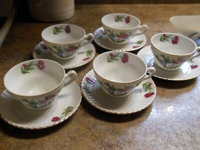 Set of 5 vintage Carnation Pattern tea cups and saucers